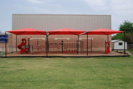 shade system over red playground